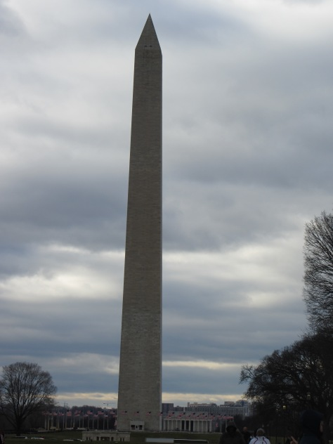 The Washington Monument against darkening clouds