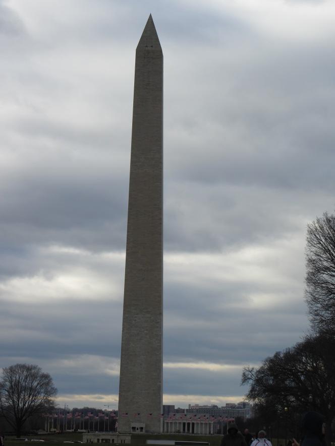 The Washington Monument against darkening clouds