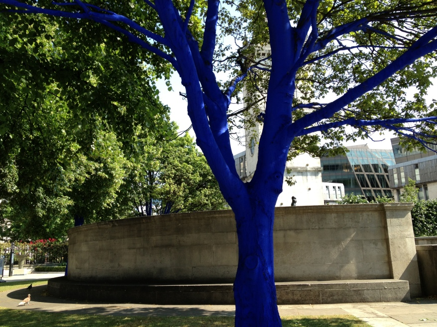 The bright blue tree trunks