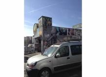 Graffiti engulfs the exterior of a souvenir shop