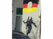 Street art depicting a broken nation