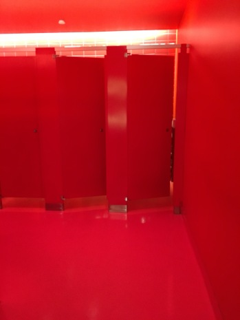 I don't remember being this excited to go to the bathroom! Each floor is done up in a different bold color.